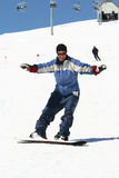 snowboardingkvinnabarn Arkivbilder