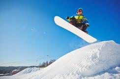 Snowboardingman royaltyfri foto