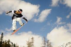 Snowboardmädchen im Rennen   Stockbild