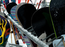 Snowboards. Many snowboards lined against a rack outside in the snow at a California ski resort Royalty Free Stock Image
