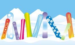 Snowboards dans la neige Photo stock