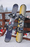 Snowboards on the fence. Two snowboards on the Fence with the mountains in the background Stock Photography