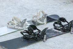 Snowboards na neve Fotografia de Stock