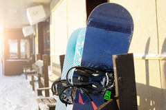 Snowboards on the rack in a Sunny day. Ski resort. Royalty Free Stock Photos