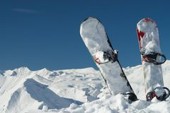 Snowboards in snowy mountains Stock Image