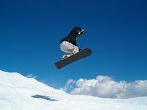 Snowborder die (meisje) springt Royalty-vrije Stock Foto's