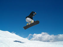 Snowborder (girl) jumping. Snowboarder jumping in the air in Italy Alps Royalty Free Stock Photos