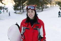 Snowborder hermoso de la muchacha Imagen de archivo