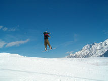 Snowborder jumping. Snowboarder jumping in the air in Italy Alps Royalty Free Stock Photos