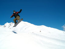 Snowborder jumping. Snowboarder jumping in the air in Italy Alps Royalty Free Stock Image