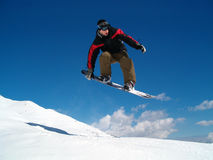 Snowborder jumping. Snowboarder jumping in the air in Italy Alps Royalty Free Stock Photo