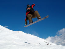 Snowborder jumping. Snowboarder jumping in the air in Italy Alps Stock Photo