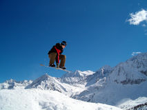 Snowborder jumping. Snowboarder jumping in the air in Italy Alps Stock Photos