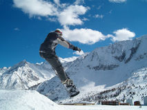 Snowborder jumping Royalty Free Stock Image