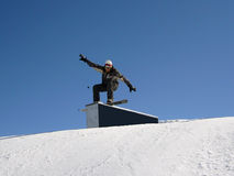 Snowborder on the ramp. Snowboarder on the ramp in snowpark Royalty Free Stock Image
