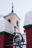 Snowbound carved gates and bell tower of The Church of St. Georg Royalty Free Stock Image
