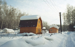 Snowbound country house Stock Images
