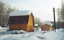 Snowbound country house Stock Photos