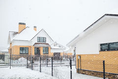 Snowbound house in cold, chilly and frosty winter time covered w Stock Images