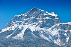Snowbound mountain peak. Stock Photos