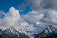 Snowbound mountain peak in a dense clouds Stock Photo