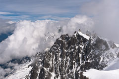 Snowbound mountain peaks in clouds Royalty Free Stock Image