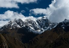 Snowbound mountain peaks and clouds in Himalayas Stock Image