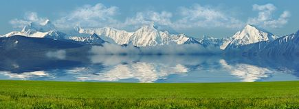 Snowbound mountains lake and meadow Stock Image