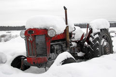 Snowbound old antique tractor in a winter wonderland royalty free stock photo
