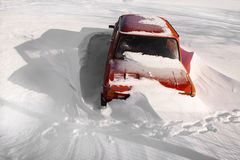 Snowbound red car Stock Images