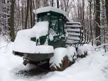 Snowbound timber vehicle Royalty Free Stock Photo