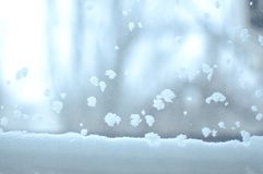 Snowbound window close-up, indoor. Seasonal winter weather conditions. Snowy winter background.  royalty free stock photography