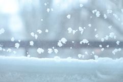 Snowbound window close-up, indoor. Seasonal winter weather conditions. Snowy winter background.  royalty free stock image