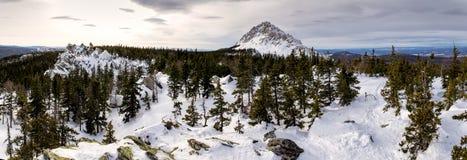 Snowbound winter landscape with mountain peak Stock Photo