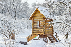 Snowbound wooden lodge. Wooden lodge on the playground in the park covered by snow Stock Images