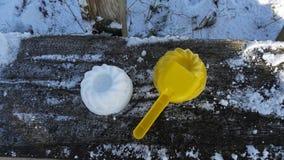 snowcake和childgame 免版税库存图片