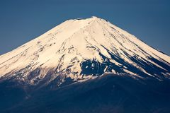 Snowcaped Mt. Fuji. View of the Mt. Fuji`s perfectly shaped and snowcaped volcano peak royalty free stock photos