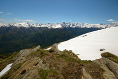 Snowcapped alpine arc in spring Stock Images