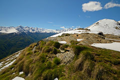 Snowcapped alpine arc in spring Stock Photo