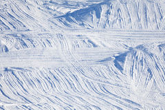 Snowcapped downhill with snowcat traces  on slope Stock Images