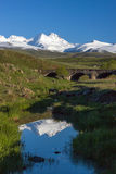 Snowcapped mount of Aragats with old bridge in front Stock Photography