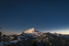 Snowcapped Mount Baker lit by the full moon, Washington state Royalty Free Stock Photo