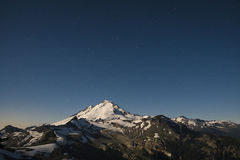 Snowcapped Mount Baker lit by the full moon, Washington state Stock Images