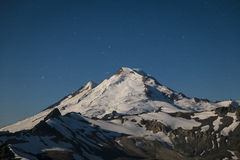 Snowcapped Mount Baker lit by the full moon, Washington state Royalty Free Stock Photos