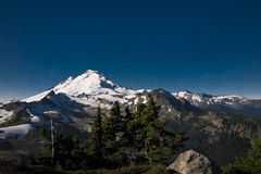 Snowcapped Mount Baker lit by the full moon, Washington state Stock Photography