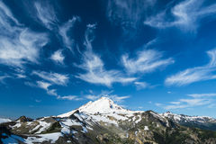 Snowcapped Mount Baker under high cirrus clouds Royalty Free Stock Image
