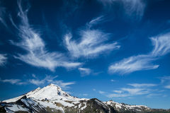 Snowcapped Mount Baker under high cirrus clouds Royalty Free Stock Photo