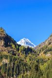 Snowcapped mountain peak Stock Images