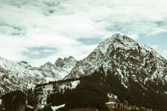 Snowcapped mountain range in spring Royalty Free Stock Photo