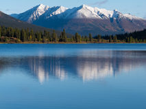 Snowcapped mountain reflection on Lapie Lake Yukon Royalty Free Stock Photography